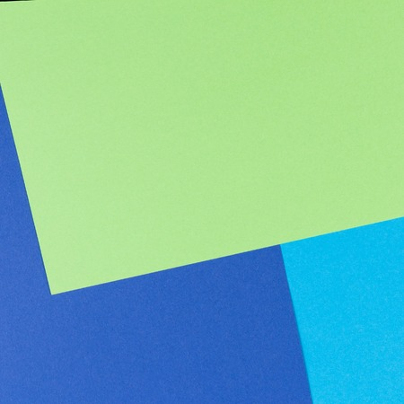 Color papers geometry flat composition background with yellow, green, white and blue tones