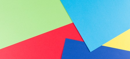 Color papers background with yellow, green, red and blue tones Stock fotó