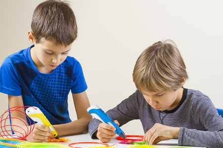 Two boys creating with 3d printing pen Stok Fotoğraf