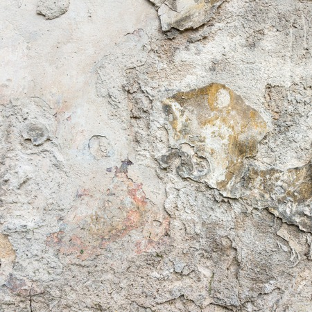 Old Wall With Peel Grey Stucco Texture. Retro Vintage Worn Wall Background. Decayed Cracked Rough Abstract Wall Surface.