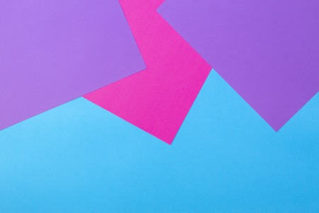 Color papers geometry flat composition background with pink violet and blue tones Stock Photo