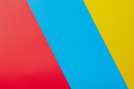 Color papers geometry flat composition background with yellow red and blue tones Stock Photo