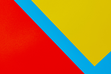 Color papers geometry flat composition background with yellow red and blue tones Imagens