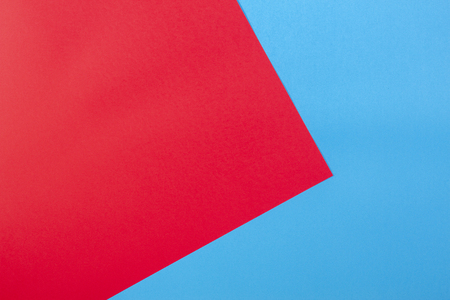 Color papers geometry flat composition background with red and blue tones