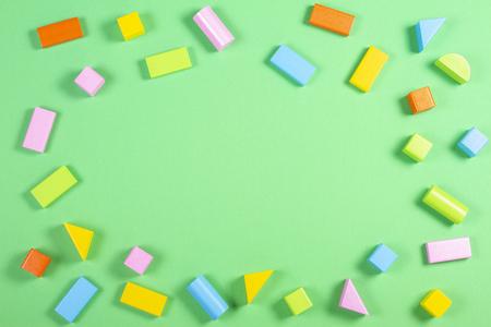 Colorful wooden blocks on green background 版權商用圖片