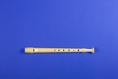 Musical instrument flute on blue color background. 写真素材