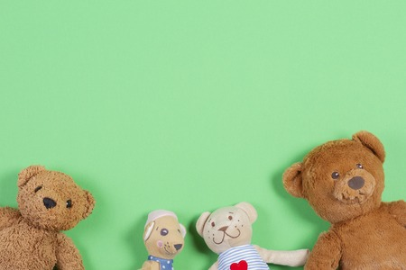 Top view with soft baby toys on green background