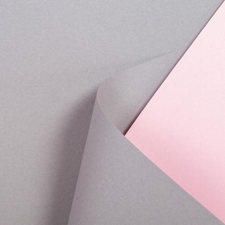 Fondo de papel de color gris y rosa de forma geométrica abstracta