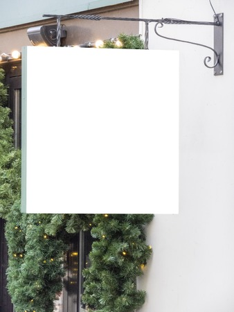 Mock up. Empty signboard of christmas decorated store, restaurant, cafe, outdoors