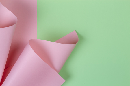 Abstract geometric shape pastel pink and green color paper background Imagens