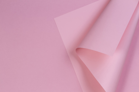 Abstract colorful background. Pastel pink paper in geometric shape