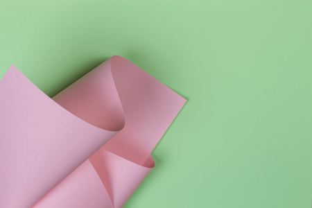 Abstract geometric shape pastel pink and green color paper background 写真素材
