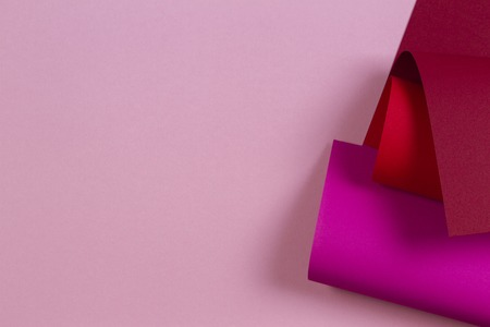 Abstract geometric shape pink magenta red color paper background