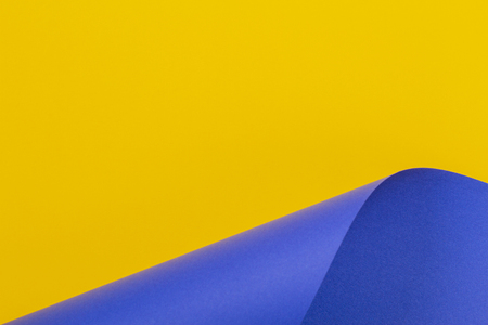 Abstract colorful background. Yellow blue color paper in geometric shapes