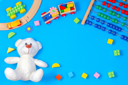 Kids toys frame on blue background. Top view. Flat lay. Copy space for text Stock Photo