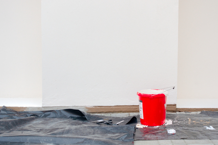 Renovation, restoration, refurbishment. Painting accessories in front of empty exterior house wall