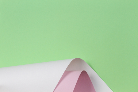 Abstract geometric shape pastel green pink and white color paper background.