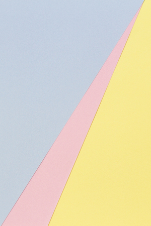 Abstract geometric shape pastel blue, pink and yellow color paper background.