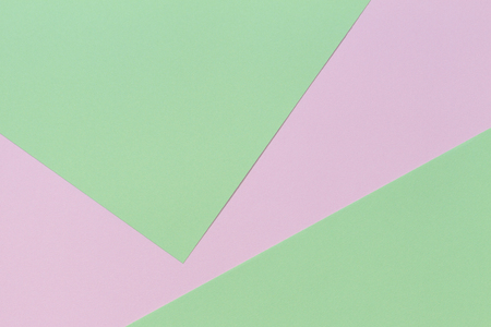 Pastel color paper background. Pink and green color layout composition