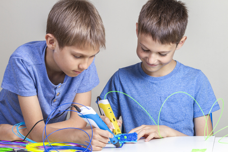 Children creating with 3d printing pens