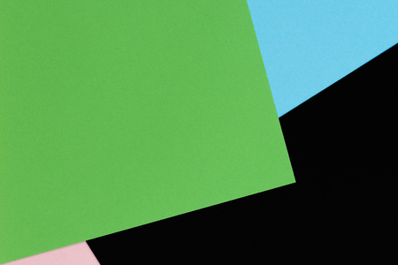 Abstract geometric shape light blue, green, pastel pink and black color paper background