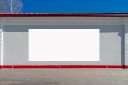 Mock up. Blank billboard outdoors, outdoor advertising board on the wall. Stock Photo