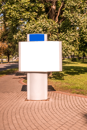 Mock up of blank billboard, outdoors advertising, information board in the city. Stock Photo