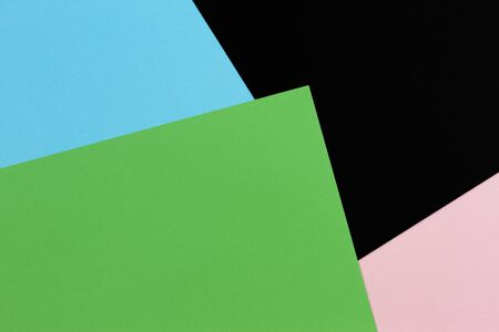 Abstract geometric shape light blue, green, pastel pink and black color paper background.