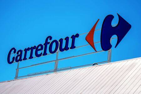 Finestrat, Spain - June 12, 2019: Carrefour logo in Finestrat Spain. Carrefour is one of the largest hypermarket chains in the world