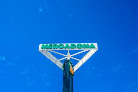 Finestrat, Spain - 18 June, 2019: : Mercadona signboard and logo over blue sky. Mercadona - popular Spanish supermarket chain