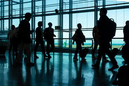 Alicante, Spain - 11 June, 2019: Silhouette of Passengers at Departure Terminal in Alicante International Airport
