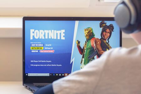 Vilnius, Lithuania - July 2, 2019: Boy playing Fortnite game. Fortnite is online video game developed by Epic Games