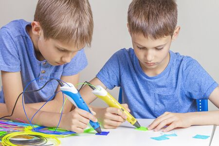 Two boys creating with 3d printing pens 写真素材