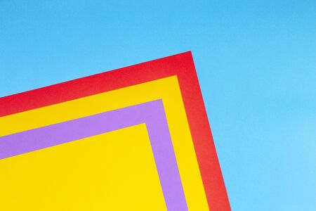 Color papers geometry flat composition background with yellow red purple and blue tones