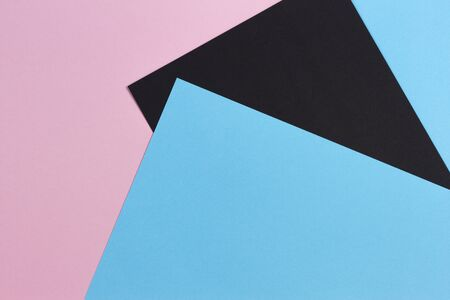 Abstract geometric shape pastel pink, light blue and black color paper background 写真素材