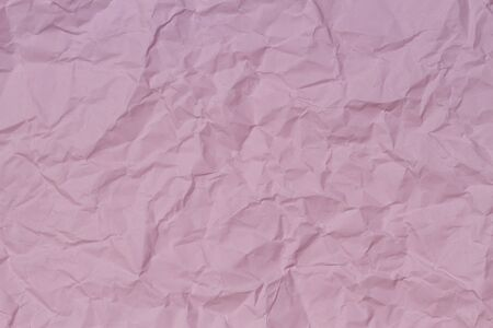 Pink crumpled wrinkled paper texture background
