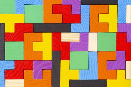 Different colorful shapes wooden blocks pattern background. Top view Stock Photo