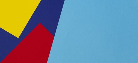Abstract blue, red and yellow color paper geometry composition background