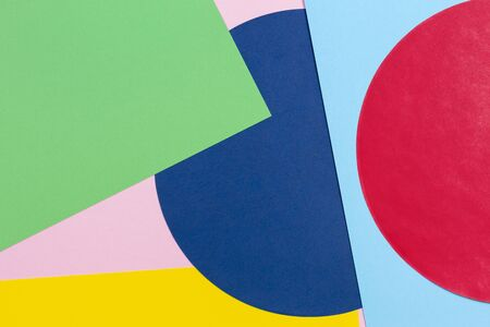 Texture background of fashion papers in memphis geometry style. Yellow, blue, light blue, green, red and pastel pink colors. Top view, flat lay