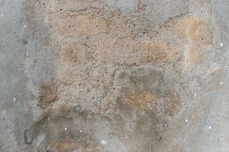Old cracked weathered shabby plastered peeled wall texture background Imagens