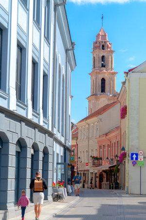 Vilnius, Lithuania - August 19, 2019: People walking in beautiful Savicius street of Vilnius old town, Lithuania Redactioneel
