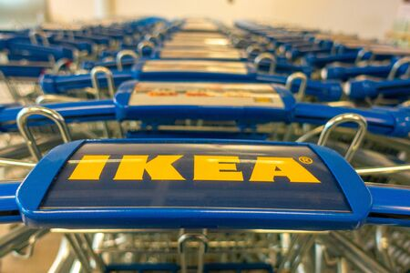 Vilnius, Lithuania - 1 October 2019: Ikea shopping carts in a row inside Ikea store Redactioneel