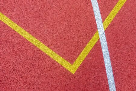 Colorful sports court background. Top view to red field rubber ground with white and yellow lines outdoors Banque d'images