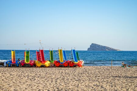 Benidorm, Spain - 16 June, 2019: Boats with a slide on the shore of Benidorm beach