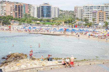 Benidorm, Spain, 16 June, 2019: People enjoying sunny day on Finestrat beach. Healthy lifestyle Redactioneel