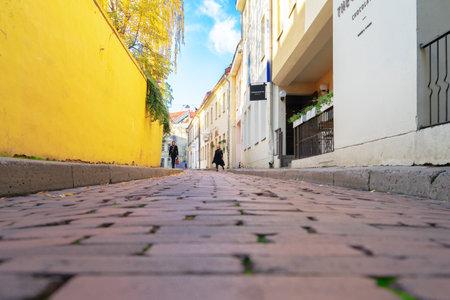 Vilnius, Lithuania - 16 October, 2019: Beautiful Vilnius oldtown street, Lithuania Redakční