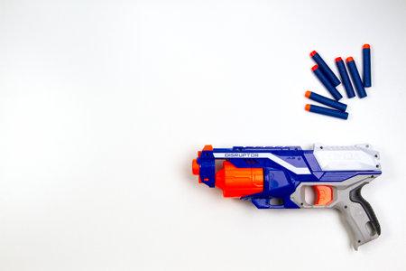 Vilnius, Lithuaania - March 5, 2019: Nerf N-Strike Elite Disruptor Blaster and Refill Bullet Darts on white background Redakční