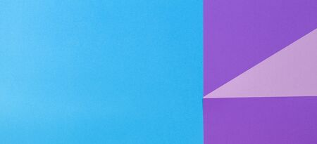 Color papers geometry flat composition background with violet and blue tones.