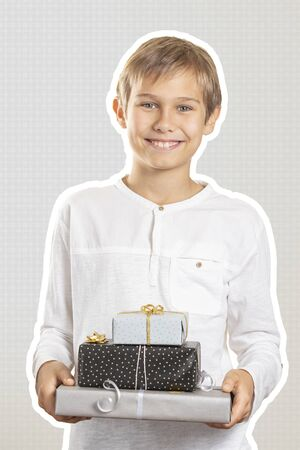 Happy boy holding stack paper wrapped present gift boxes. Magazine collage style with light grey color background. Holidays, Christmas concept