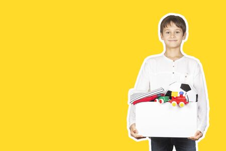 Donation concept. Kid holding donate box with clothes, books, school supplies and toys. Magazine collage style with yellow color background
